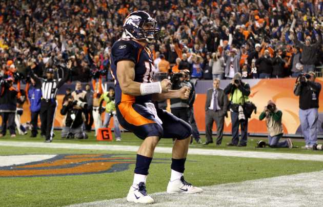 T. Tebow scores the game-winning touchdown against New York (US Presswire).