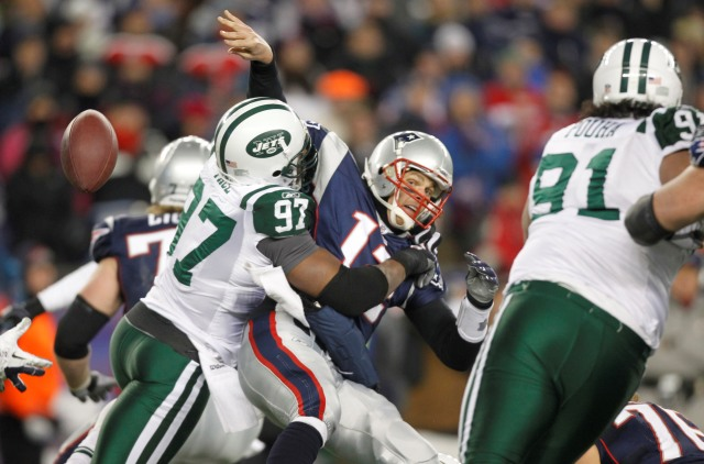T. Brady is sacked by C. Pace in the 2010 AFC playoffs (US Presswire).