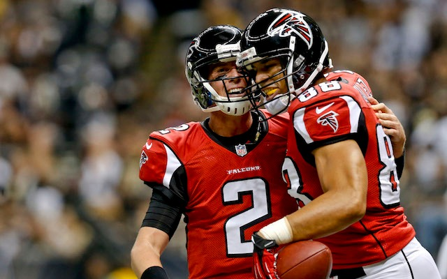 Tony Gonzalez celebrates with his almost-elite quarterback. (USATSI)