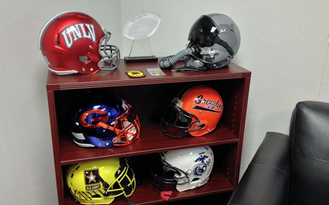 Tony Sanchez's office includes a variety of interesting helmets. (Dennis Dodd)