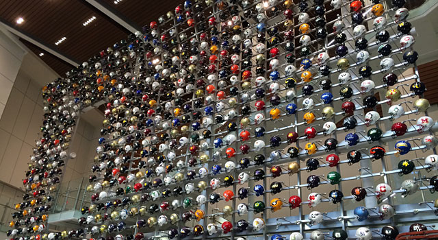The wall of helmets. When you enter the museum, you can choose your alma mater and your school's football helmet will light up. (Provided)