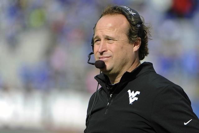Oliver Luck says Dana Holgorsen will be back on the West Virginia sidelines in 2014.  (USATSI)