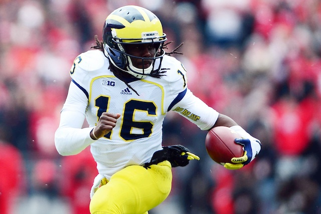 Former Michigan quarterback Denard Robinson is the cover athlete for EA Sports' NCAA Football 14, in stores July 9. (USATSI)