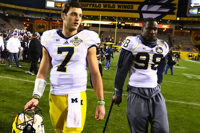 Michigan QBs Devin Gardner and Shane Morris will compete for the starting job in 2014.  (USATSI)