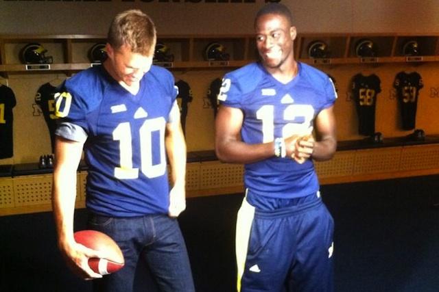 Devin Gardner and Tom Brady pose in uniform on Thursday in Michigan's locker room. (Michigan Athletics/Twitter.com)