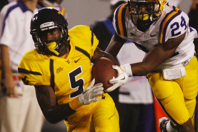 Dana Holgorsen is giving Ivan McCartney (No. 5) a chance to earn his spot back on West Virginia's roster. (USATSI)