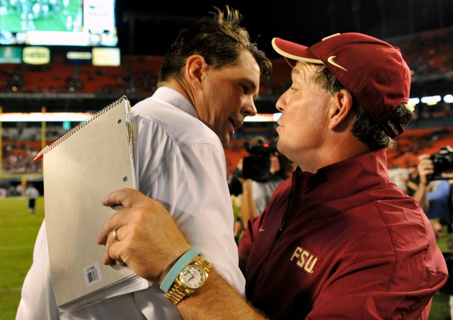 According to the spread Saturday's game won't be as close as Al and Jimbo are in this photo