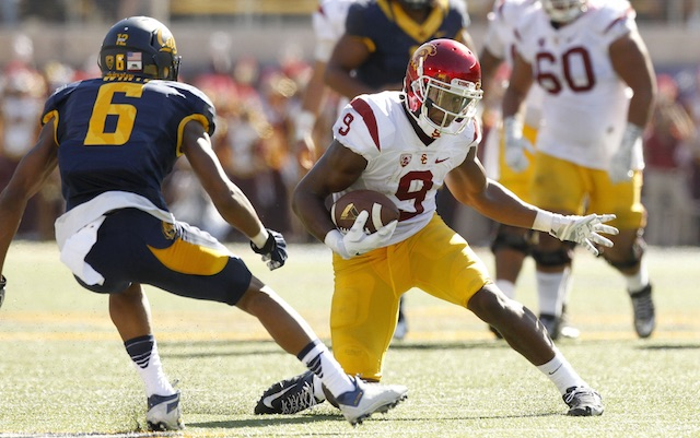 011ae8932ee USC WR JuJu Smith-Schuster (hand) had to have his helmet taken away ...
