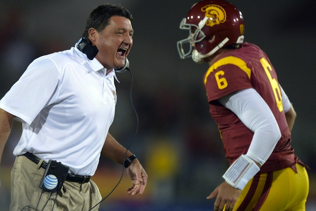 Ed Orgeron and Cody Kessler celebrate a touchdown against Arizona on Thursday. (USATSI)