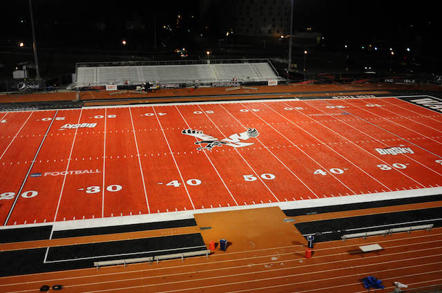 The red turf of Roos Field will host the first game of the 2014 season