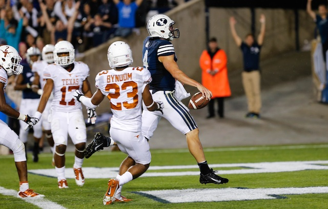 BYU QB Taysom Hill ran for 258 yards and three touchdowns on Saturday