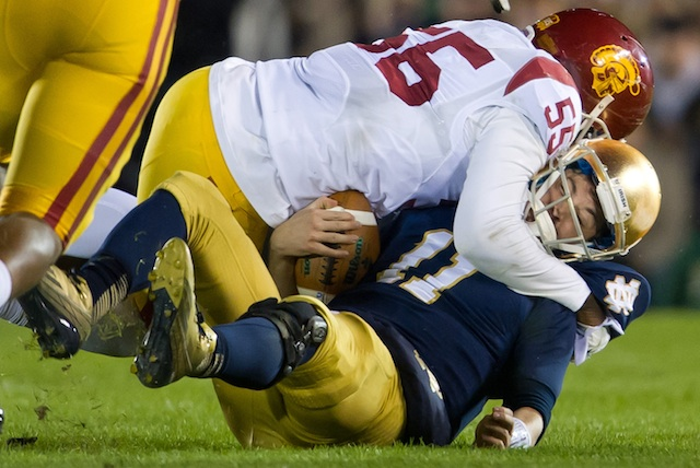 Tommy Rees left the game after being sacked by USC's Lamar Dawson