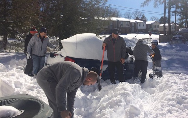 Uva-coaches-dig-snow-out-sled-stadium
