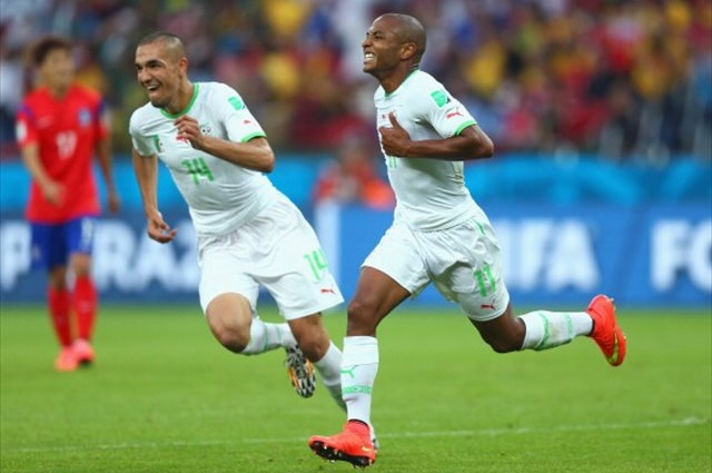 Yacine Brahimi (right) celebrates a classic goal to secure all three points for Algeria. (Getty Images)