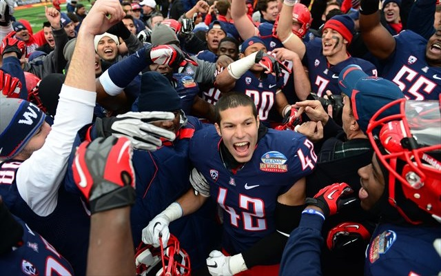 Arizona players sullenly react to their meaningless win in the 2012 New Mexico Bowl. (USATSI)