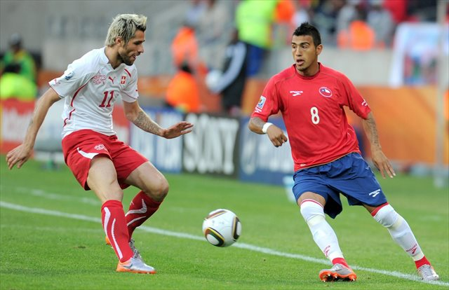 Arturo Vidal (right, at the 2010 World Cup) faces fitness questions for Chile. (USATSI)