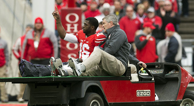 J.T. Barrett is carted off the field after fracturing his right ankle. (USATSI)