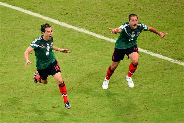 Chicharito Hernandez (right) was the driving force behind Mexico's 3-1 victory. (USATSI)