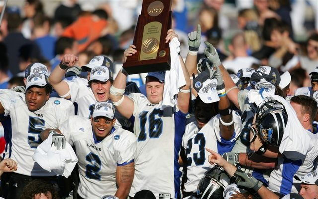Cullen Finnerty (No. 16) lifts the 2006 Division II national championship trophy. (USATSI)