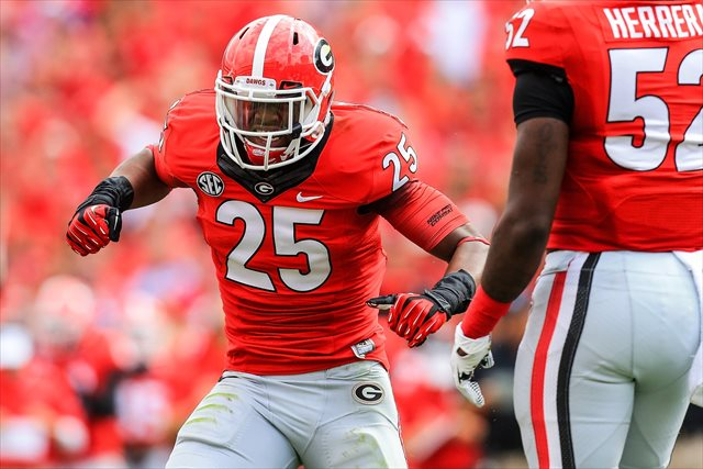 Josh Harvey-Clemons faced a three-game suspension to begin the 2014 season. (USATSI)