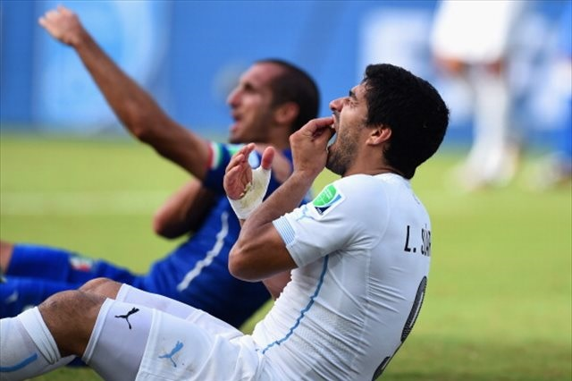 Luis Suarez's apparent bad behavior has once again rocked the World Cup. (Getty Images)