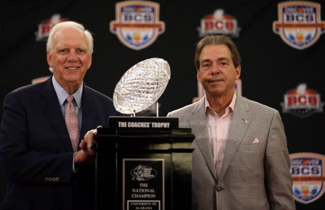 Mal Moore (left) and Nick Saban celebrated three BCS titles together. (Getty Images)
