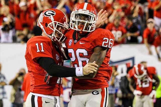 Malcom Mitchell and Aaron Murray won't share the same field until this fall after Mitchell's injury. (USATSI)
