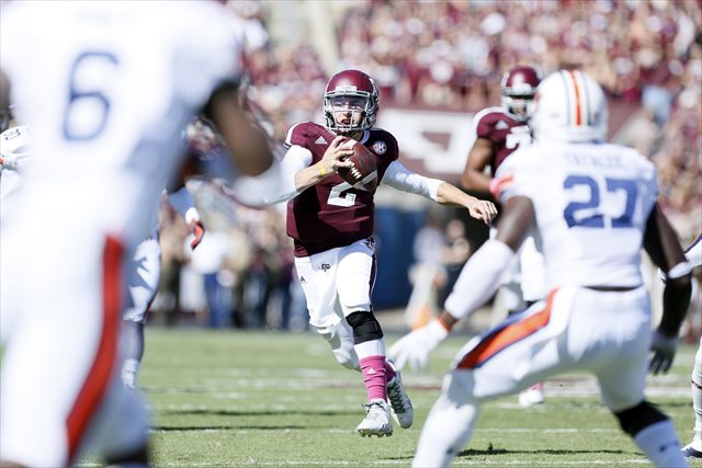 Johnny Manziel left the field after a big hit vs. Auburn. (USATSI)