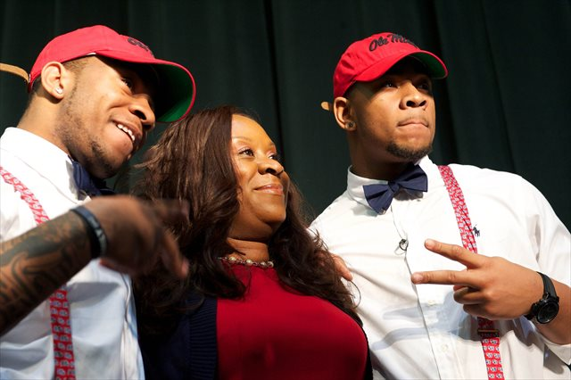 Denzel (left) and Robert Nkemdiche celebrate with their mother, Beverly, on Signing Day 2013. (USATSI)