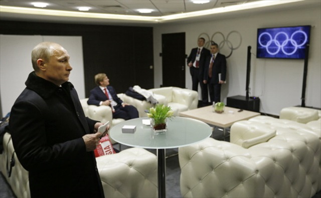 Vladimir Putin waits for his introduction at the 2014 Sochi opening ceremonies. (Getty Images)