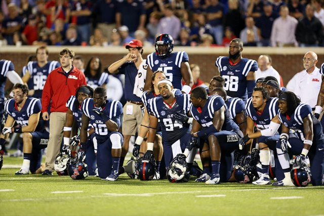 The Rebels watch and wait as Serderius Bryant is treated on the field vs. Texas A&M Saturday. (USATSI)