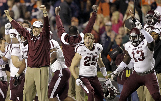 Texas A&M celebrates after recovering a fumble in the final minute of the game. (USATSI)