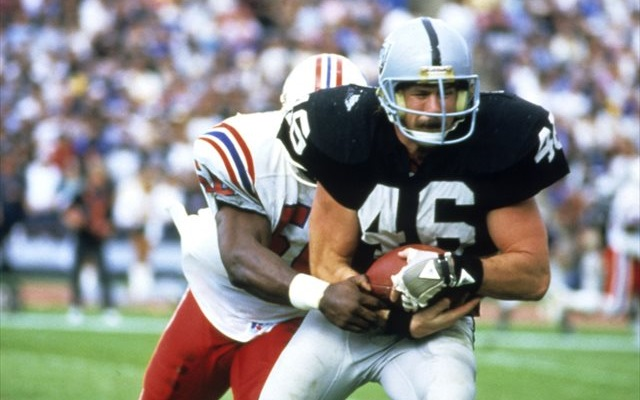 Todd Christensen faces the Patriots in a 1985 playoff game. (Getty Images)