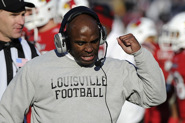 Charlie Strong will cut off an agent from the Louisville program if they contact players during the season. (USATSI)