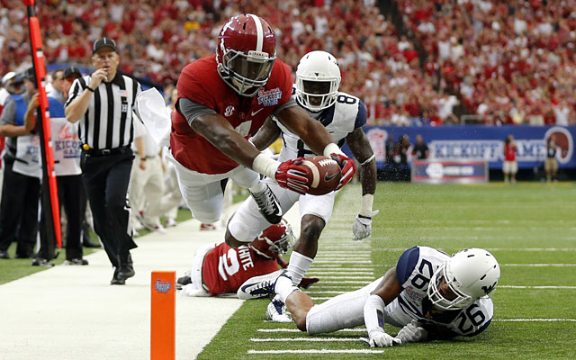 T.J. Yeldon dives for a touchdown in the first half against West Virginia. (USATSI)