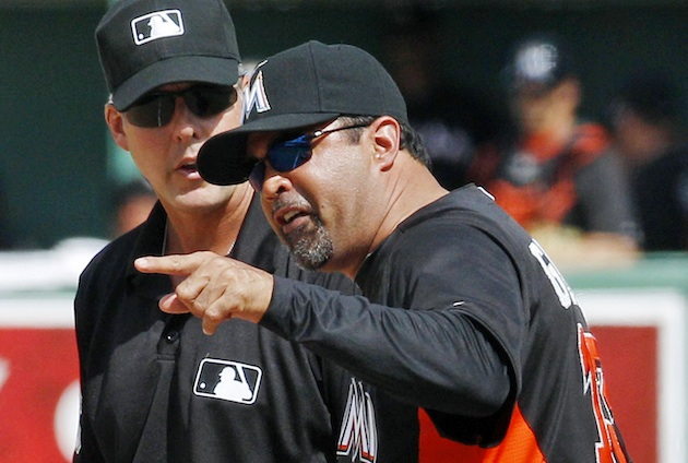 Marlins' OZZIE GUILLEN ejected as Bobby Valentine waves goodbye