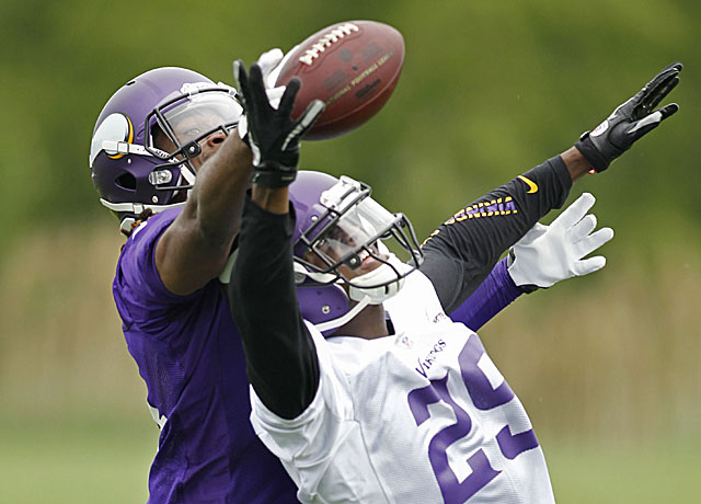 The Vikings' other two first-round draft picks -- CB Xavier Rhodes (right) and WR Cordarrelle Patterson -- compete for the ball during workouts. (USATSI)