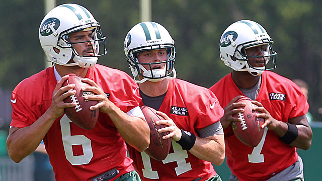 Jets quarterbacks (left to right) Mark Sanchez, Greg McElroy and rookie Geno Smith work on their form. (USATSI)