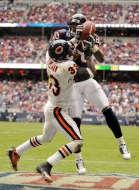 A. Johnson makes a TD catch over Chicago's C. Tillman (Getty).