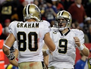D. Brees and J. Graham celebrate a New Orleans win (Getty).