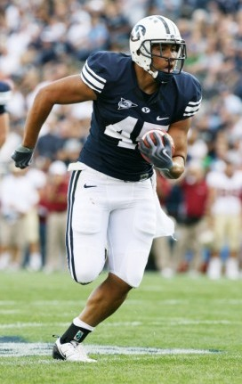 H. Unga running the ball while at BYU (Getty)