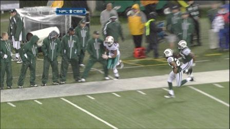 This is what occured when N. Carroll was running down the sidelines and appeared to trip over a New York official.