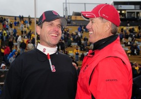Jim Harbaugh (left) and John Elway have some issues to discuss (US Presswire).