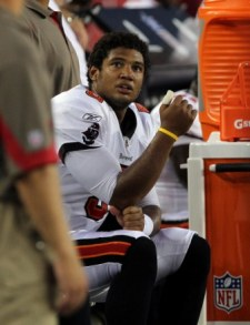 J. Freeman sits on the sidelines after hurting his thumb Saturday night (US Presswire).
