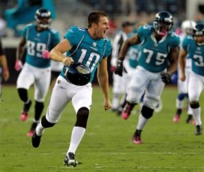 J. Scobee celebrated after kicking his 59-yard game winning field goal (AP).