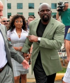 Lawrence Taylor and his wife, Lynette leave a Rockland County (N.Y.) courtroom (AP).