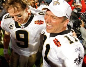 M. Brunell (right) celebrates New Orleans' Super Bowl win with D. Brees (Getty).