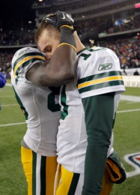 D. Driver consoles M. Flynn after Green Bay's loss (US Presswire).
