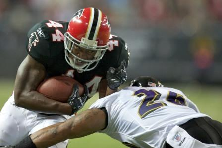 Baltimore safety D. Landry, seen here getting run over by Atlanta's J. Snelling for a touchdown, was one reason Baltimore's defense underperformed Thursday (US Presswire).