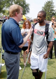 Roger Goodell speaks with CB D. Foxworth at Baltimore camp on Wednesday (AP).
